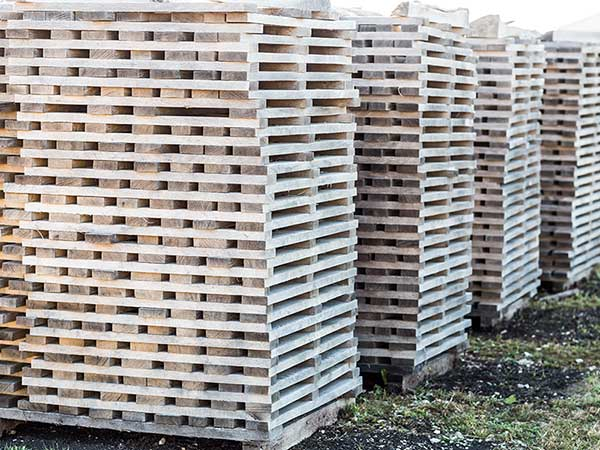Stave wood is stored exposed to the elements as part of the aging process